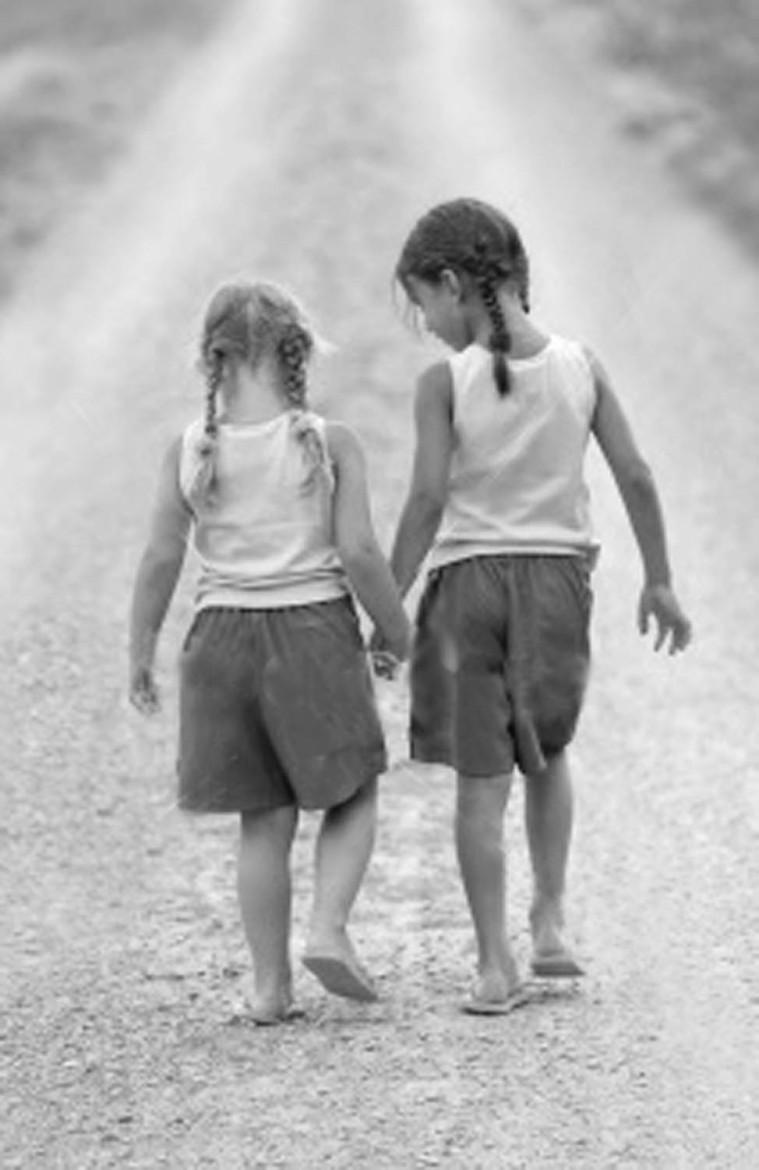 girls-holding-hands-bw
