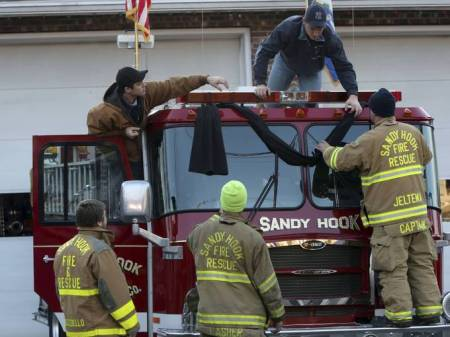 Sandy Hook Firefighters Hanging Black Bunting Mary Altaffer, AP