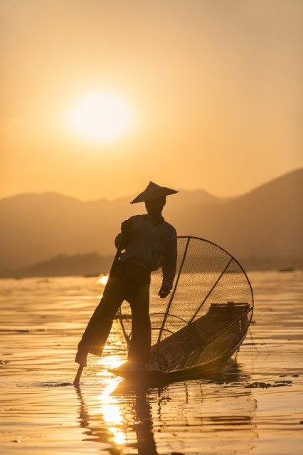 Spear Fisherman Rowing Boat with his Leg, Myanmar Inle Lake by Sean Caffrey Nat Geo
