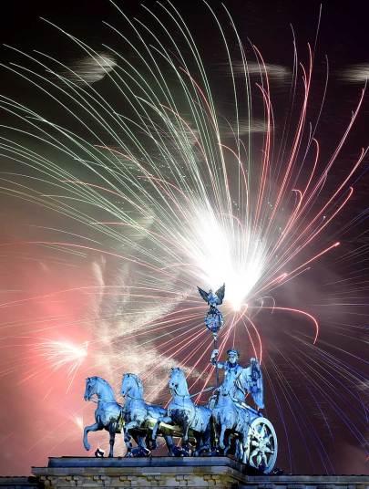 Fireworks behind Berlin's Brandenburg Gate Tobias Schwartz AFP 2014